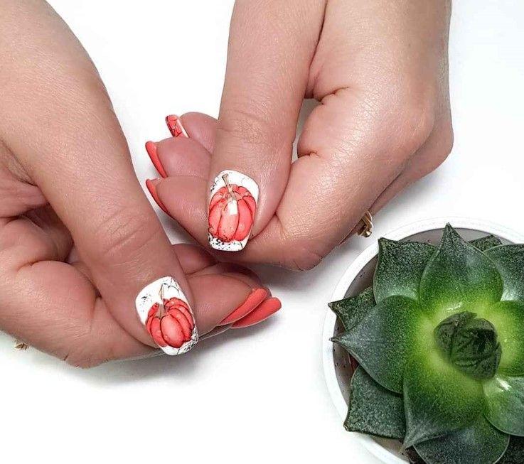 Маникюр с тыквами - идея оформления ногтей осенью